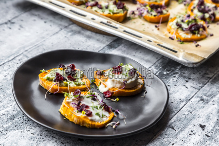slices of sweet potato with cream