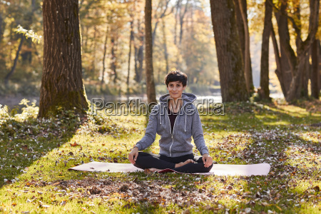 mid adult woman practicing yoga at