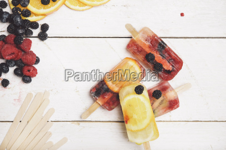 ice cream and fruits on white