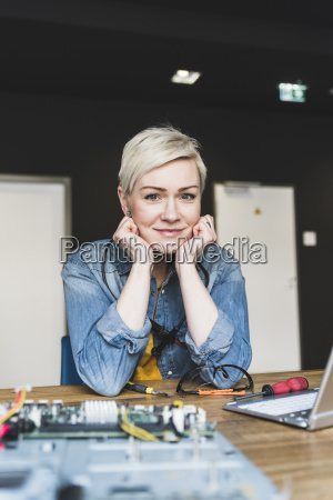 portrait of smiling woman with laptop