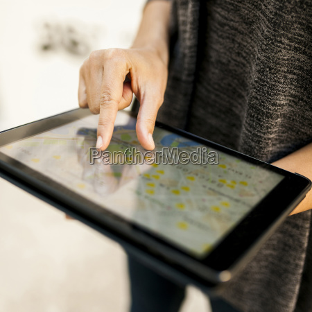 close up of woman using tablet