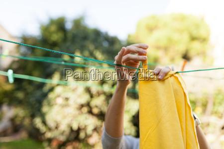 close up of woman hanging up