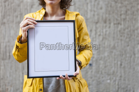 close up of woman holding blank