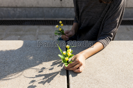 close up of woman holding yellow