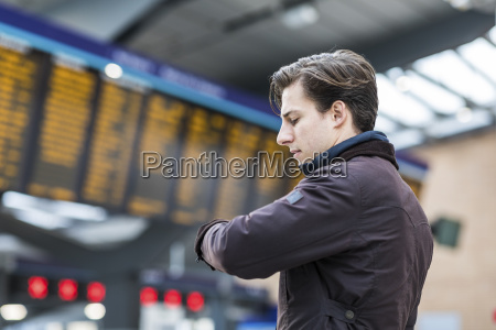 uk london businessman at train station