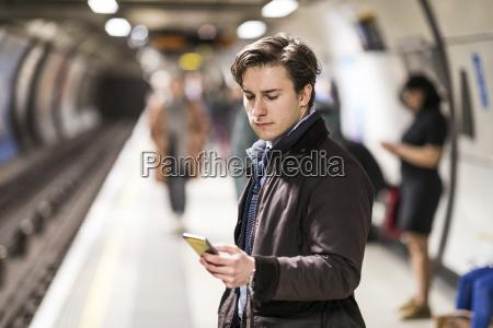 uk london businessman waiting at underground