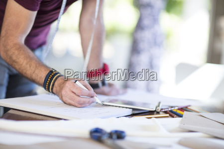 close up of fashion designer taking