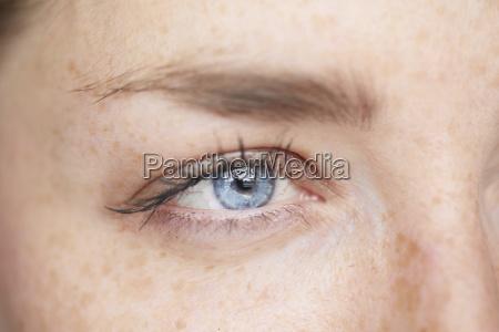 womans blue eye close up