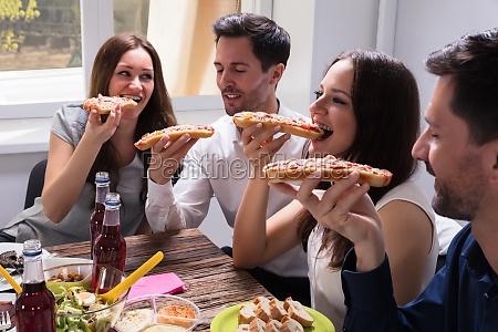 friends eating delicious bruschetta