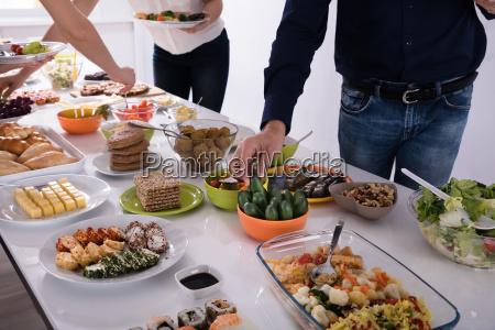 people picking food at party