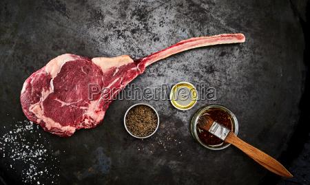 tender raw trimmed bone in ribeye