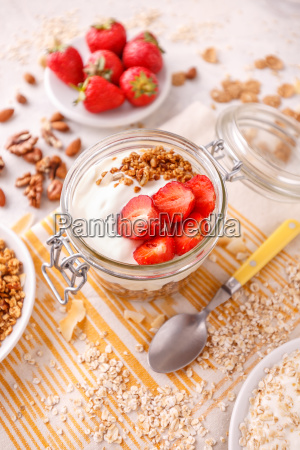 glass jar of oat granola