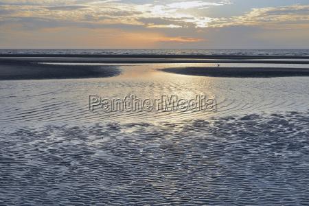 sandbank with draining water evening mood