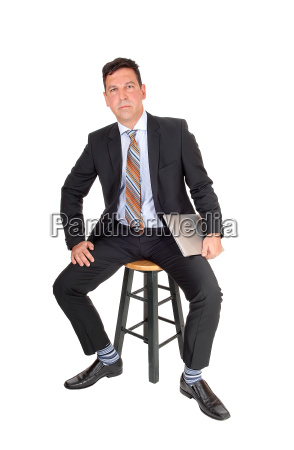 business man sitting with laptop in
