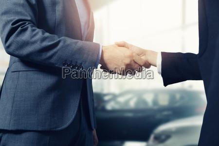 salesman and customer handshake after successful