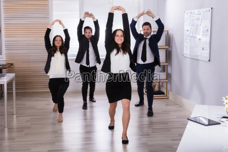 businesspeople doing stretching exercise