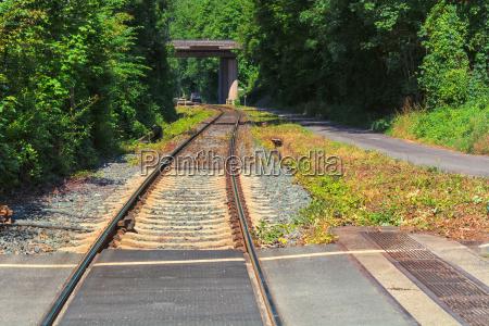 railway track rails sleepers stones close