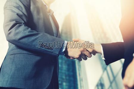 businessmen meeting and handshake in front