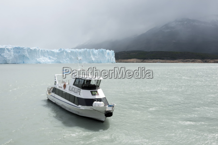 boat on lake argentino at moreno