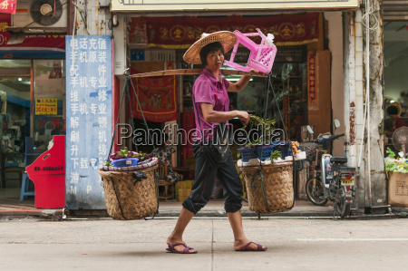 a woman carrying her shopping purchases