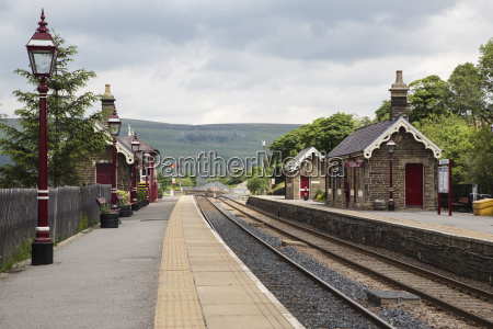 small stone train station building with