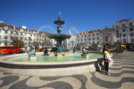 fountain in rossio square baixa lisbon