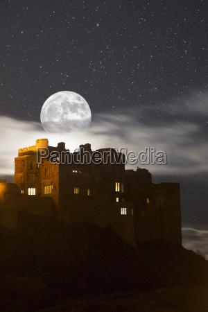 full moon glowing in a starry