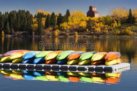upside down kayaks on a dock