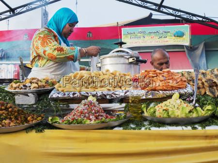 vendors preparing food to sell marrakech