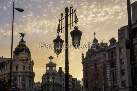 ornate lamp post and historic buildings
