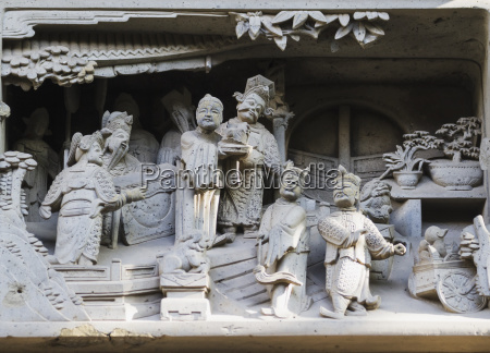 stone carvings of daily life in