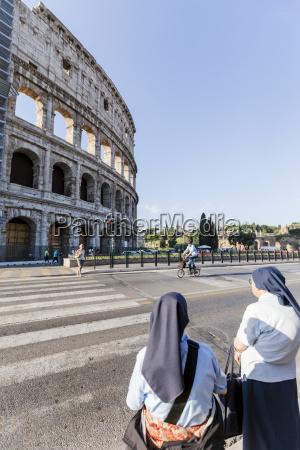 a pair of catholic nuns outside