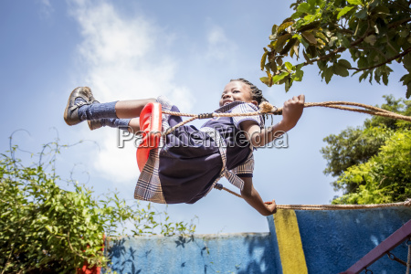 a young girl swinging on a