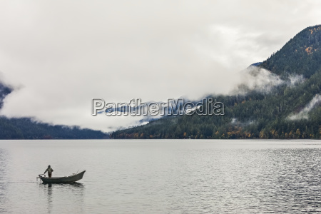fisherman on lake crescent in traditional