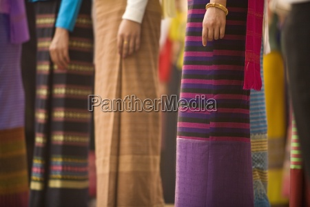 thai women in traditional dresses in