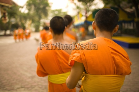buddhist monks collecting food and special