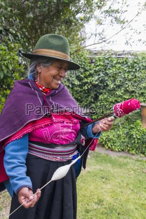 old woman spinning cotton at hacienda