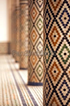 mosaic tiled pillars inside mnebhi palace