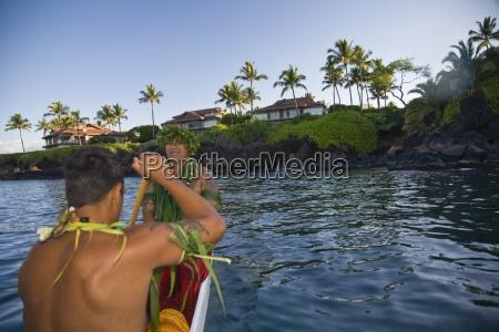 waileahawaiiusahawaiian men paddling a canoe