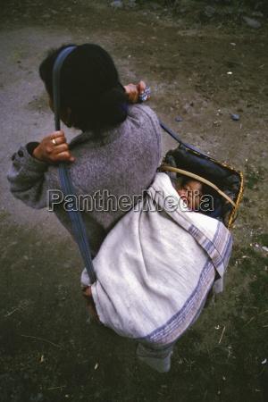 mother carrying child lukla solo khumbu