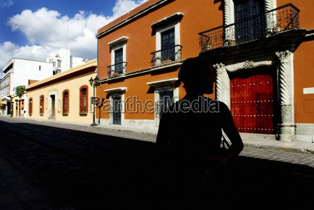street scene with a silhouetted person