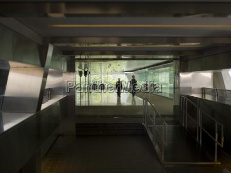 people walking inside modern building hong