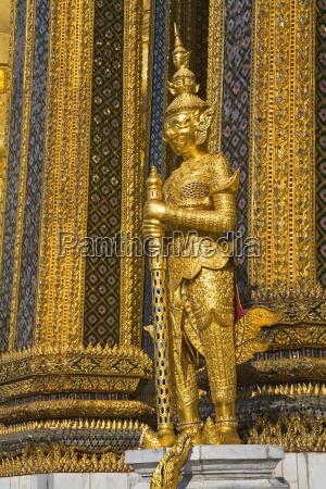 statue guarding phra mondop at royal