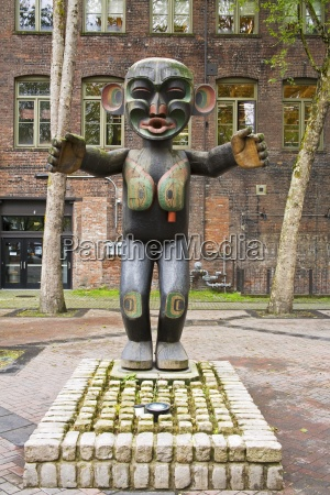 wooden statue in pioneer square seattle