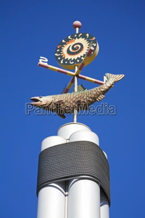 weather vane on information pole seattle