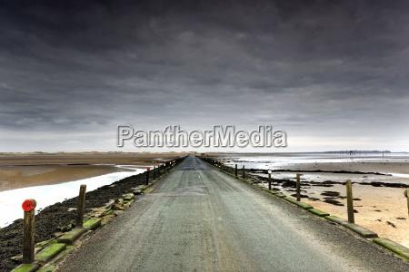 small road near a beach northumberland