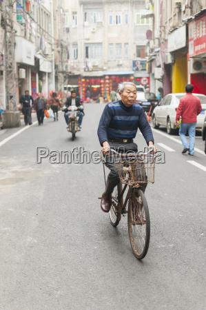 a senior man cycling in a