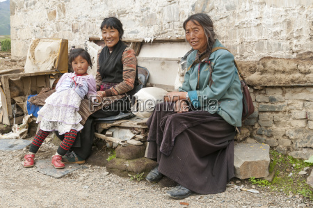 two tibetan women and a young