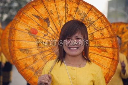 woman with parasol in flower festival