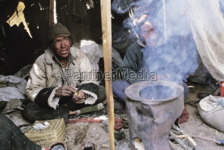 people sitting in a tent namche